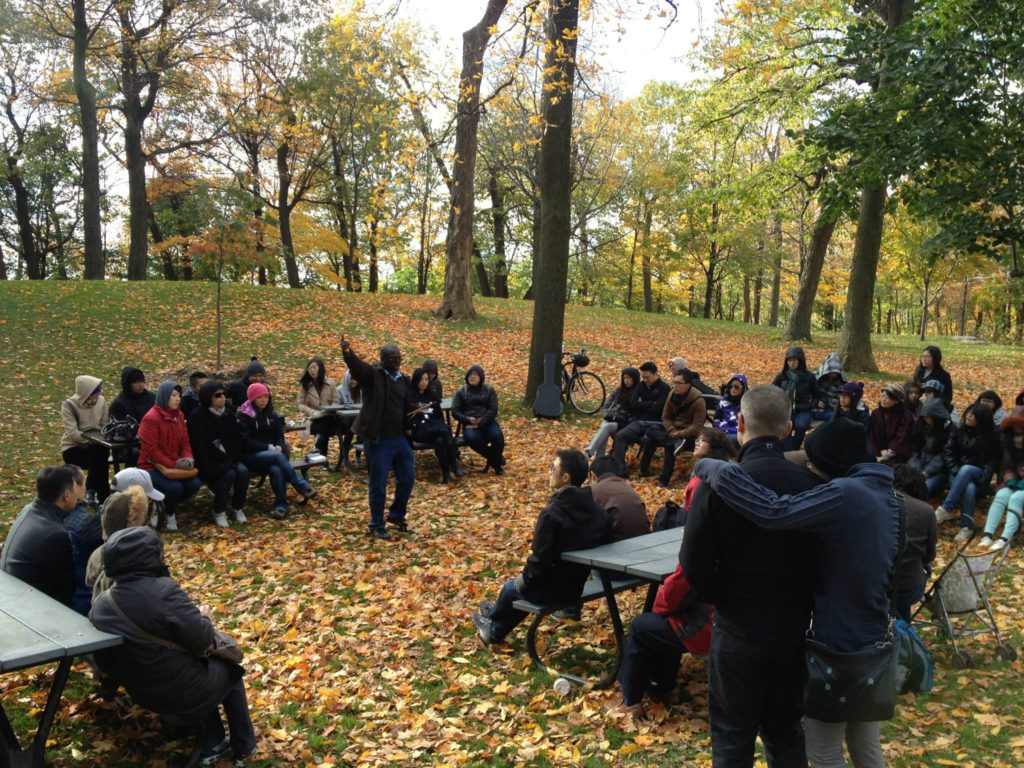Yaw preaching in the park in Montreal at an outdoor service